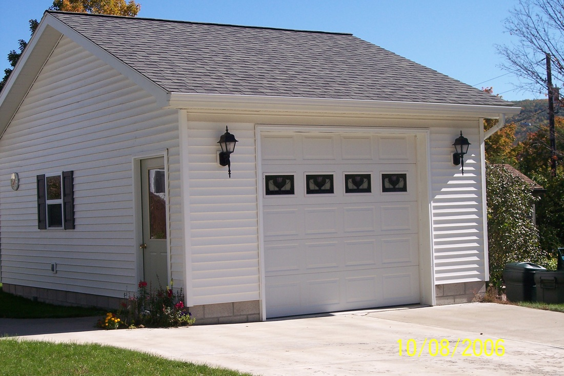 Garages wes potter construction inc for Cost to build a single car garage